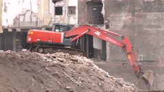 A red Digger in a construction area - stock footage