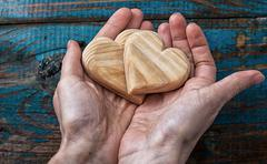 two symbolic wooden heart - stock photo