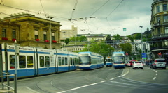 Electric city tram moving from the main train station of the Zurich, pan Stock Footage