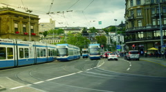Electric city tram moving from the main train station of the Zurich, zoom out Stock Footage