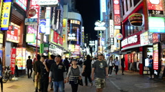Time Lapse - Busy Shibuya Shopping District at Night - Tokyo Japan Stock Footage