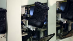 View of fixed boots on automatic machine Stock Footage