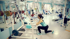 Beautiful sexy woman goes in for sports in the gym 6 Stock Footage
