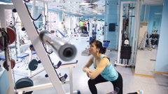 Beautiful sexy woman goes in for sports in the gym 4 Stock Footage