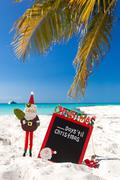 count down till  christmas holiday on tropical vacation - stock photo