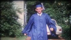 1470 - the graduate in his cap and gown  - vintage film home movie Stock Footage