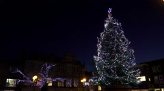 Christmas tree festive urban street scene - stock footage