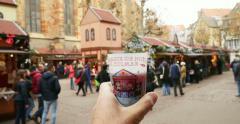 Hand holding Spiced mulled wine - gluhwein at Christmas market Stock Footage