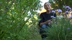 Argentina - Picking Herbs in Garden - Rio Alumine Lodge Stock Footage