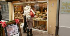 People doing Christmas shopping of traditional cake sweets Stock Footage