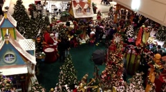 Children and parents wait in line at coquitlam center mall to visit and have Stock Footage