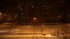 Cars drive at night in snow storm Stock Footage