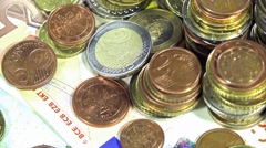 Rotating banknotes and coins (not loopable) Stock Footage