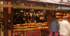 Christmas market chalet selling hand-made wooden object Stock Footage