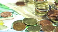 Banknotes and coins (not loopable) Stock Footage