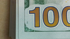 Close up of 100 on the one hundred dollar bill  - stock footage