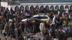 Crowd of people shopping in Kabul market Stock Footage