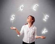 young lady standing and juggling with currency icons - stock photo