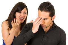 young angry woman screaming at boyfriend husband - stock photo