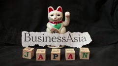 "LUCKY ASIAN WAVING CAT - ""BUSINESS ASIA"" Japan Stock Footage"