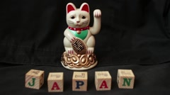 "LUCKY ASIAN WAVING CAT - ""JAPAN"" Dolly left and back Stock Footage"