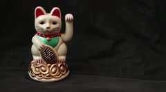 LUCKY ASIAN WAVING CAT - Dolly left with cat on screen left, return Stock Footage