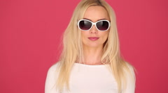 Vivacious woman in trendy sunglasses Stock Footage