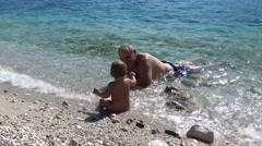 Granddad with grandson in the sea 2 Stock Footage