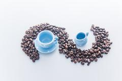 coffee beans with blue espresso dishware - stock photo