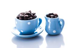 blue espresso dishware with coffee beans - stock photo