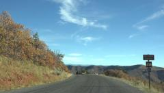 Driving across top of scenic mountain pass Autumn 4K 040 Stock Footage