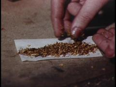 Cigarette Rolling and Smoking (Archive Footage) 1980s Stock Footage