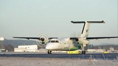 Two engine propelle commuter passenger airplane taxiing Stock Footage