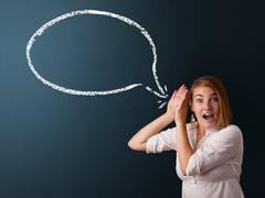 Young woman with modern speech bubble - stock photo