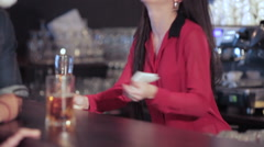 Cute girl at the bar smiling boy in a funny in Santa hat - stock footage