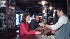 The bartender gives the drink tube in two fun girl - stock footage