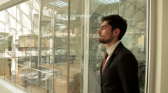 Businessman is walking around office building. Stock Footage