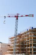 House exterior in construcion and crane Stock Photos