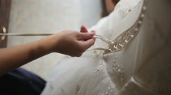 Lacing up a corset of a wedding dress Stock Footage