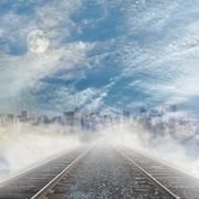 Rails to foggy city skyline with cloudy sky and full moon. Stock Illustration