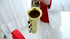 Man in festive costume plays saxophone Stock Footage