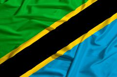 Tanzania flag on a silk drape waving Stock Illustration