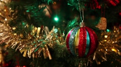 Beautiful christmas decorations on christmas tree, lights and balls with tinsel - stock footage