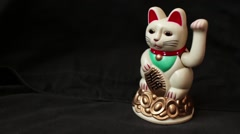 LUCKY ASIAN WAVING CAT - Lucky cat on right, dolly left and back again Stock Footage