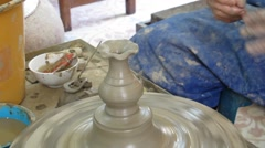 Teaching Traveler Child make pottery at Koh Kret Island in Nonthaburi Thailand. Stock Footage