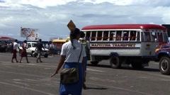 School kids run to bus Stock Footage