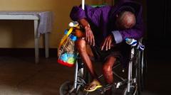 Beggar on Wheelchair Sleeping Stock Footage