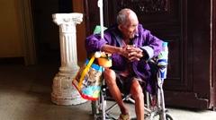 Old Beggar on Wheelchair Stock Footage