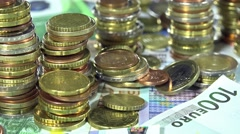 Euro banknotes and coins (dolly shot) Stock Footage