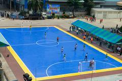 Sportsmen train on blue stadium Stock Photos